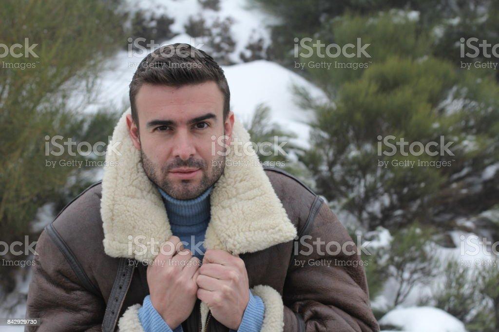 Man with I am freezing expression stock photo