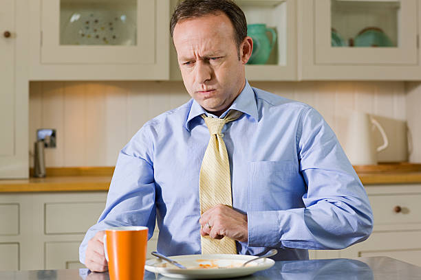 Man with indigestion stock photo