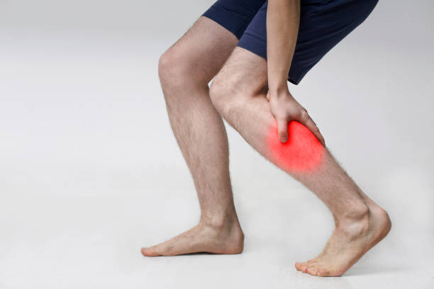 Man with injured calf, massaging painful leg muscle Man with injured calf, massaging painful leg muscle with red sore spot acute angle stock pictures, royalty-free photos & images