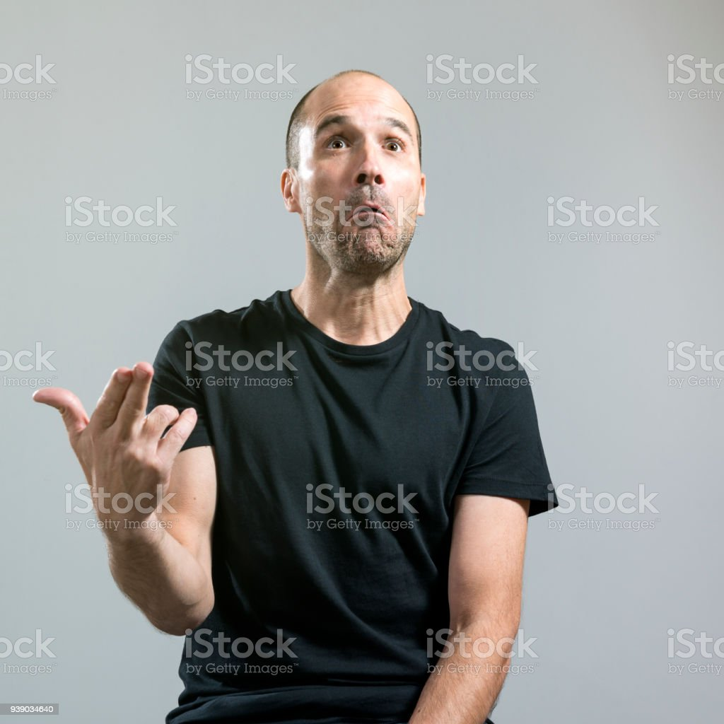 Man with irony sad face stock photo