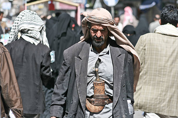 Man with janbiya in the old town of Sanaa (Yemen). stock photo