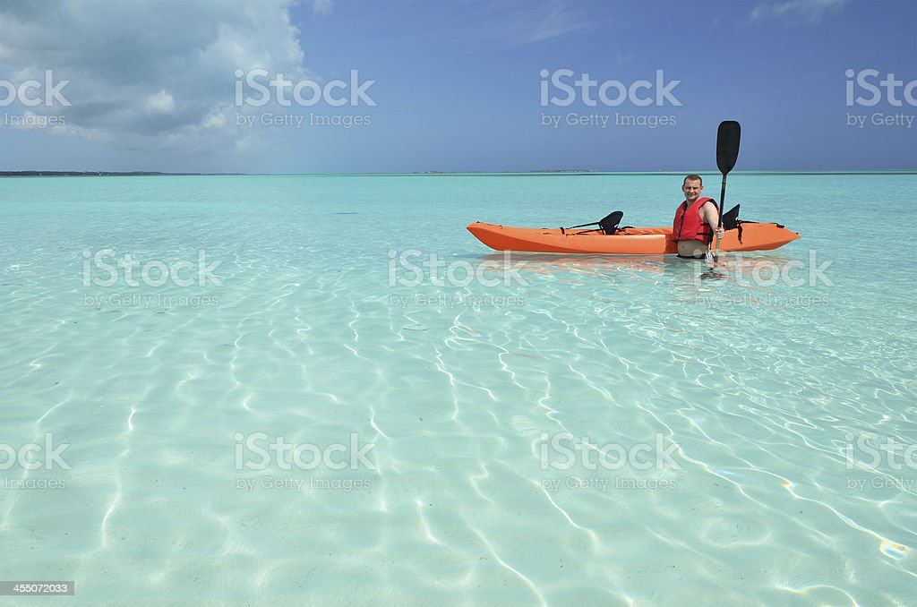 Man with kayak. Exuma, Bahamas stock photo