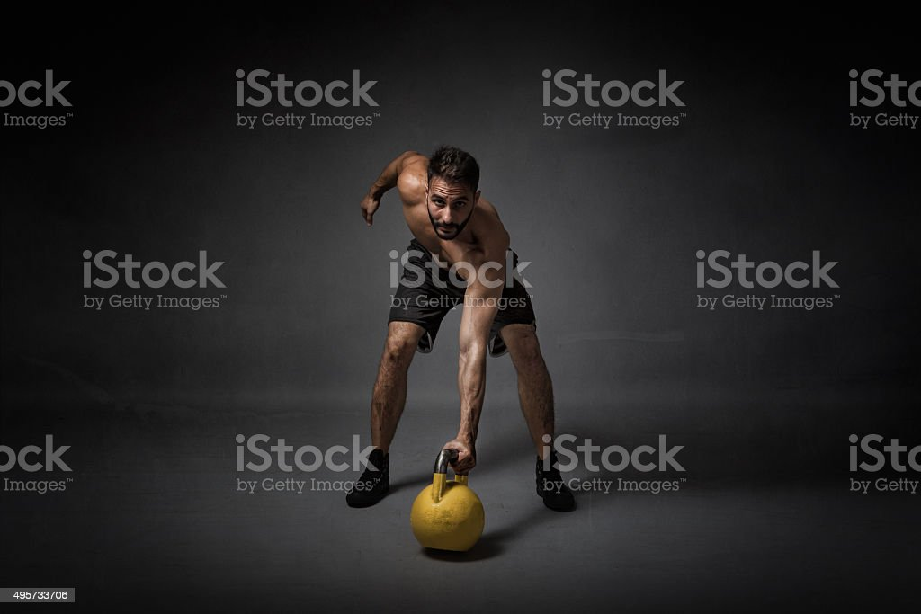 man with kettleball on hand stock photo