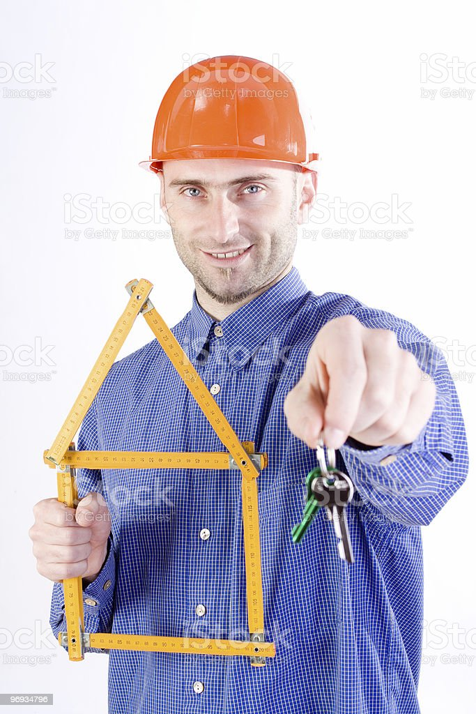 Man with keys and rulers royalty-free stock photo