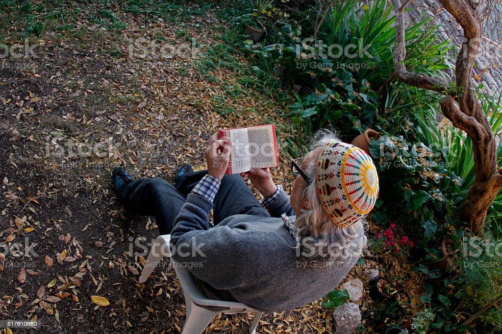 Man with kippah reading hebrew bible stock photo