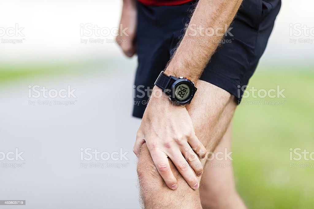 Man with knee pain from running injury royalty-free stock photo