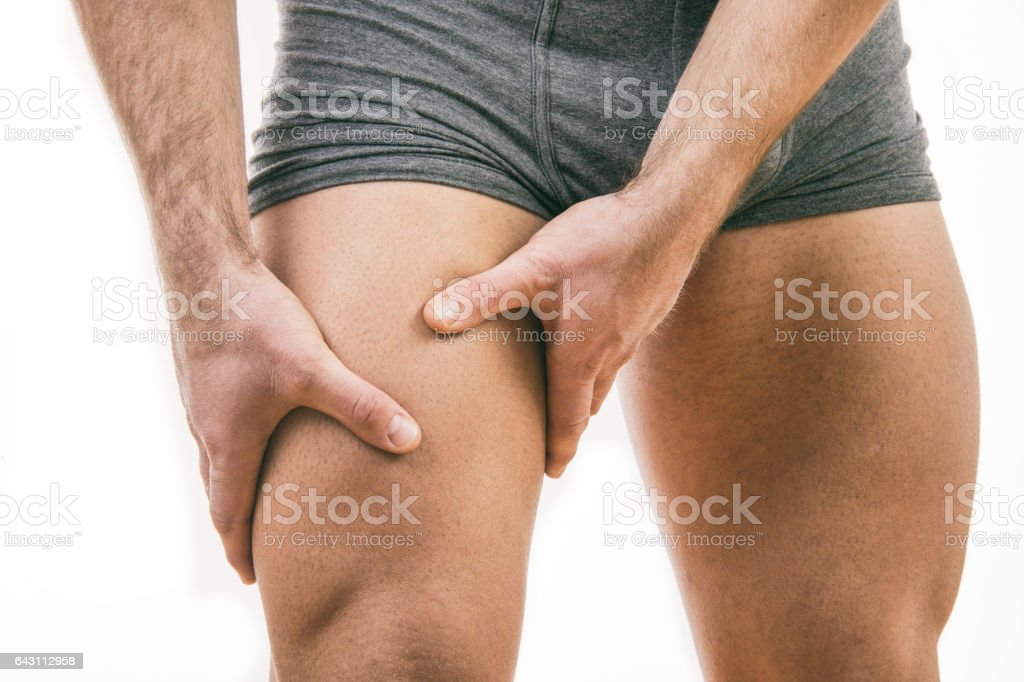 Man with knee pain over white background stock photo