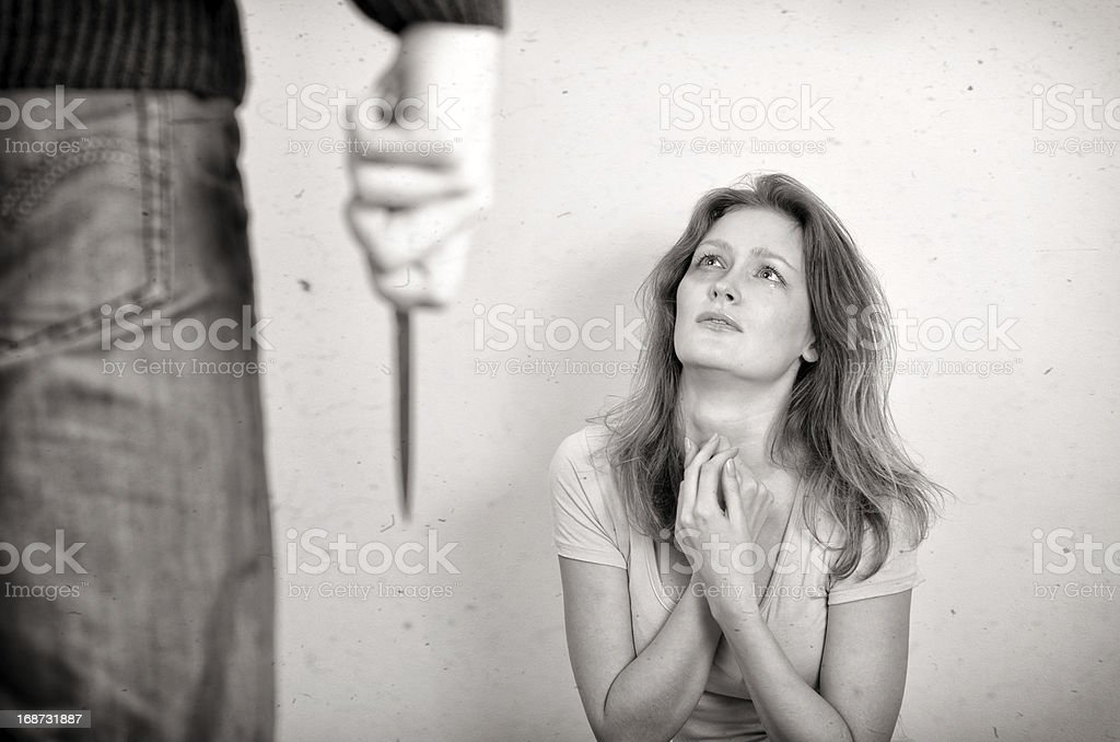 Man with knife coming to his wife. royalty-free stock photo