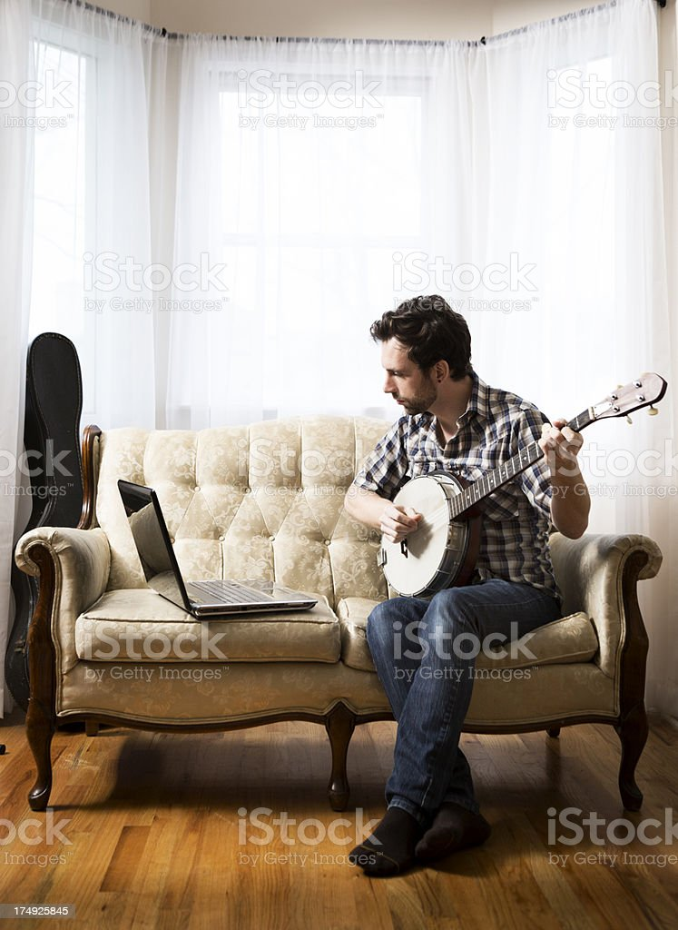 Man with Laptop and Banjo stock photo