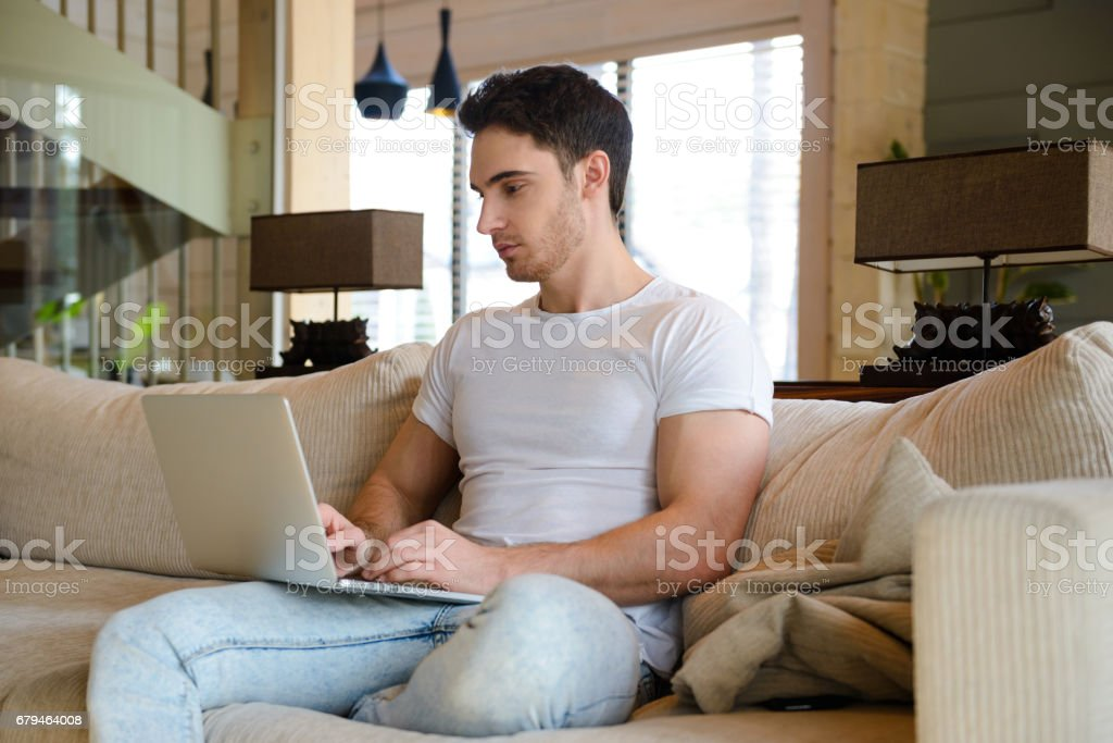 Man with laptop in living room royalty-free stock photo