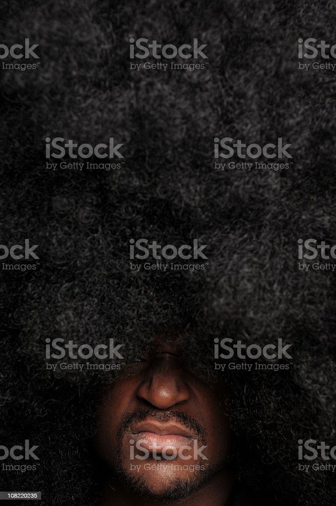 Man with Large Afro Hairstyle Sneering royalty-free stock photo