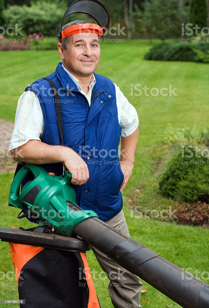 Man with leaf blower royalty-free stock photo