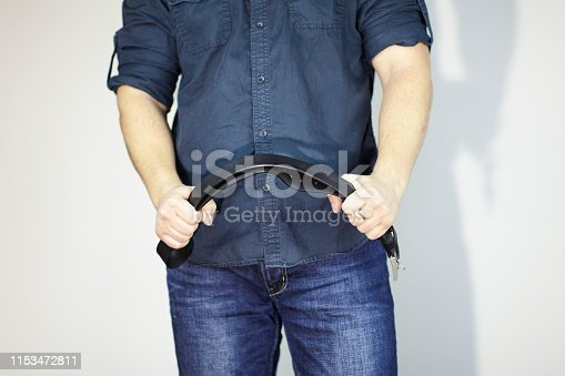 Man with leather belt