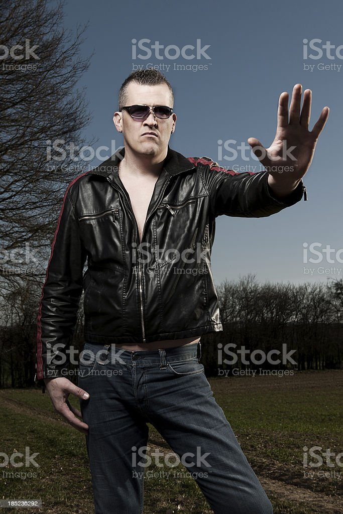 Man with leather jacket in nature royalty-free stock photo