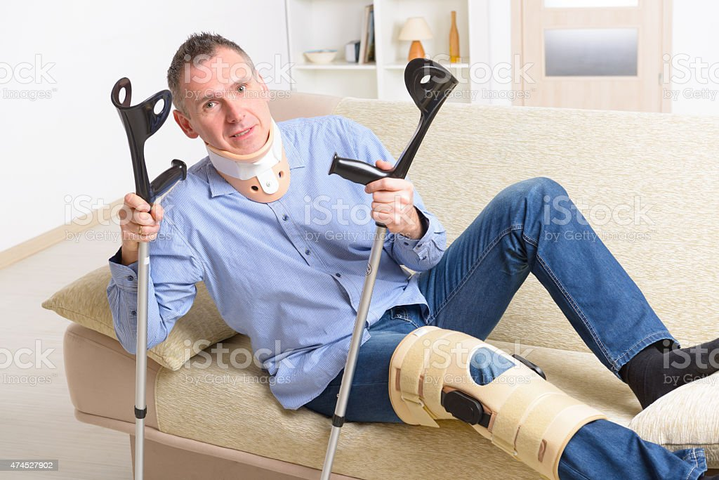 Man with leg in knee cages stock photo