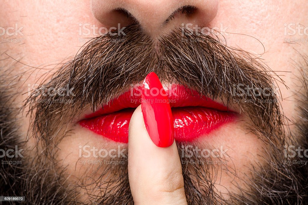 Man with Lipstick and Nail Polish stock photo