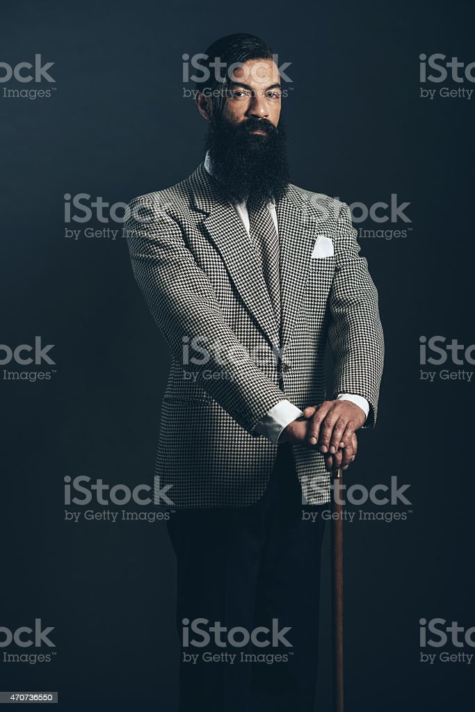 Man with Long Beard in Formal Wear Holding Cane stock photo