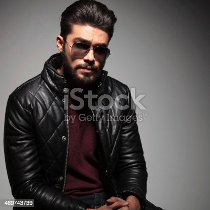 istock man with long beard is sitting and looking sad 469743739