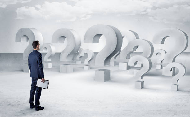 Man with  lot of question mark signs and icons stock photo