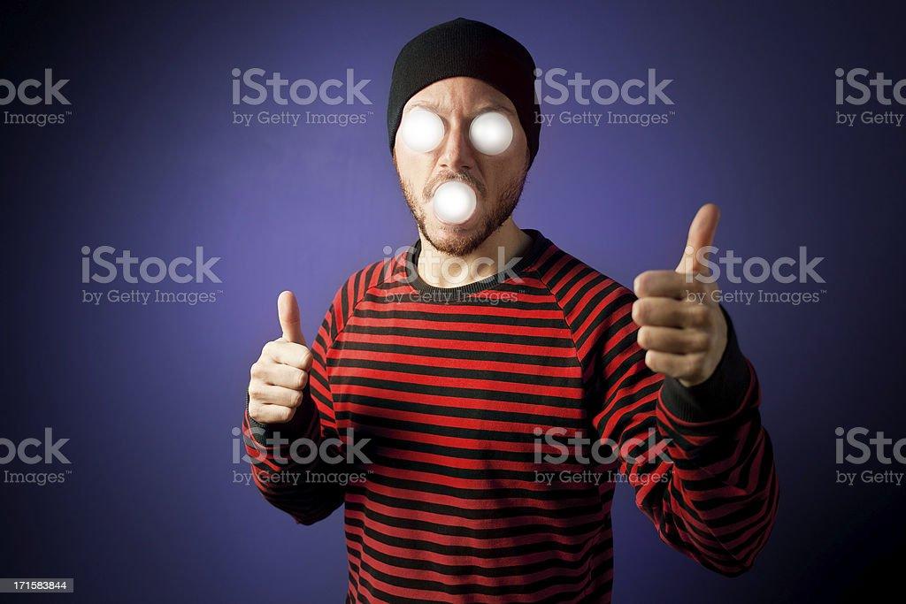 Man with luminous eyes thumbs up royalty-free stock photo
