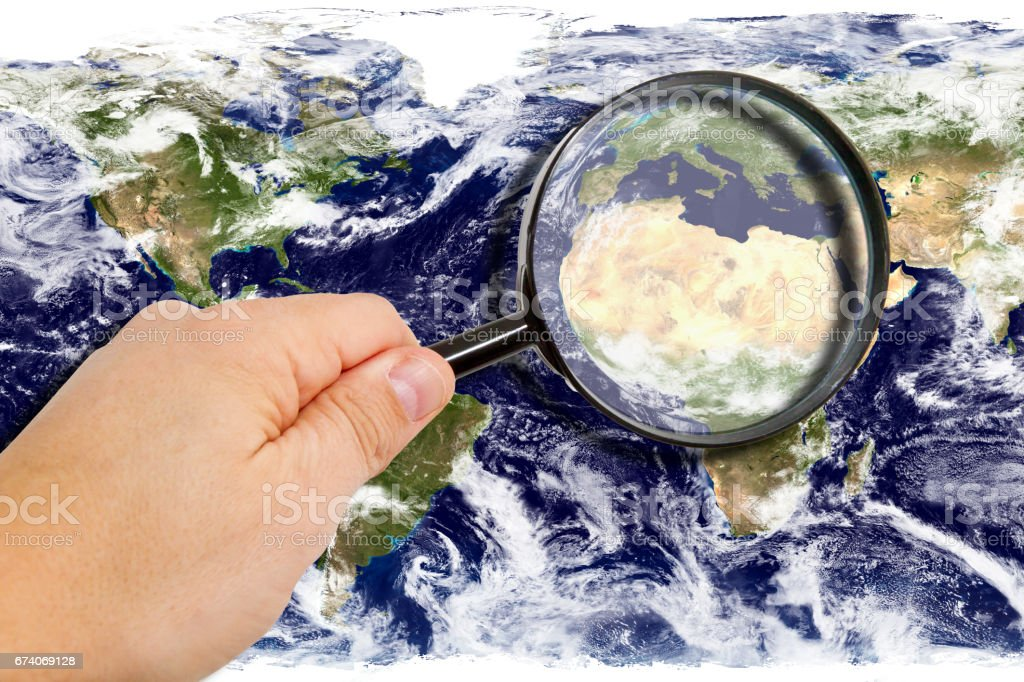 Man with magnifier and world map royalty-free stock photo