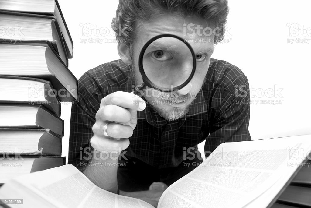 Man with magnifier royalty-free stock photo