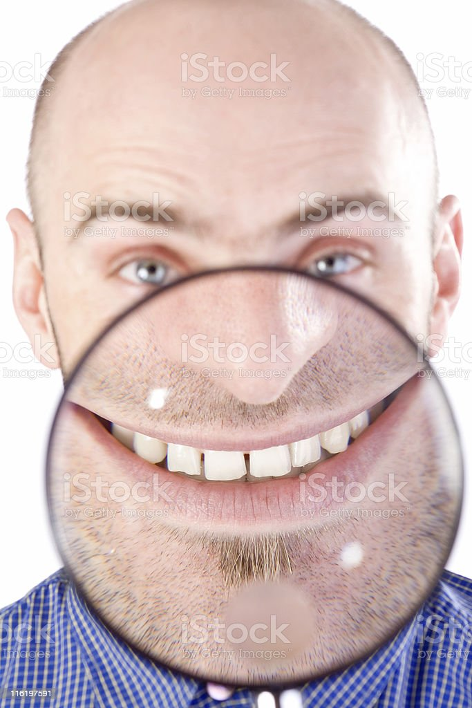 Man with magnifying glass Man with magnifying glass held up to face, enlarging mouth and chin Adult Stock Photo