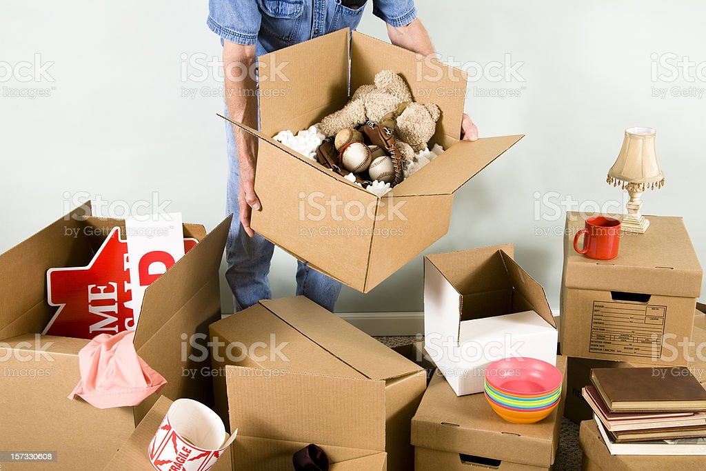 Man with many packed boxes for moving day. royalty-free stock photo