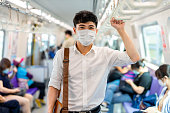 istock man with mask in metro 1253777085