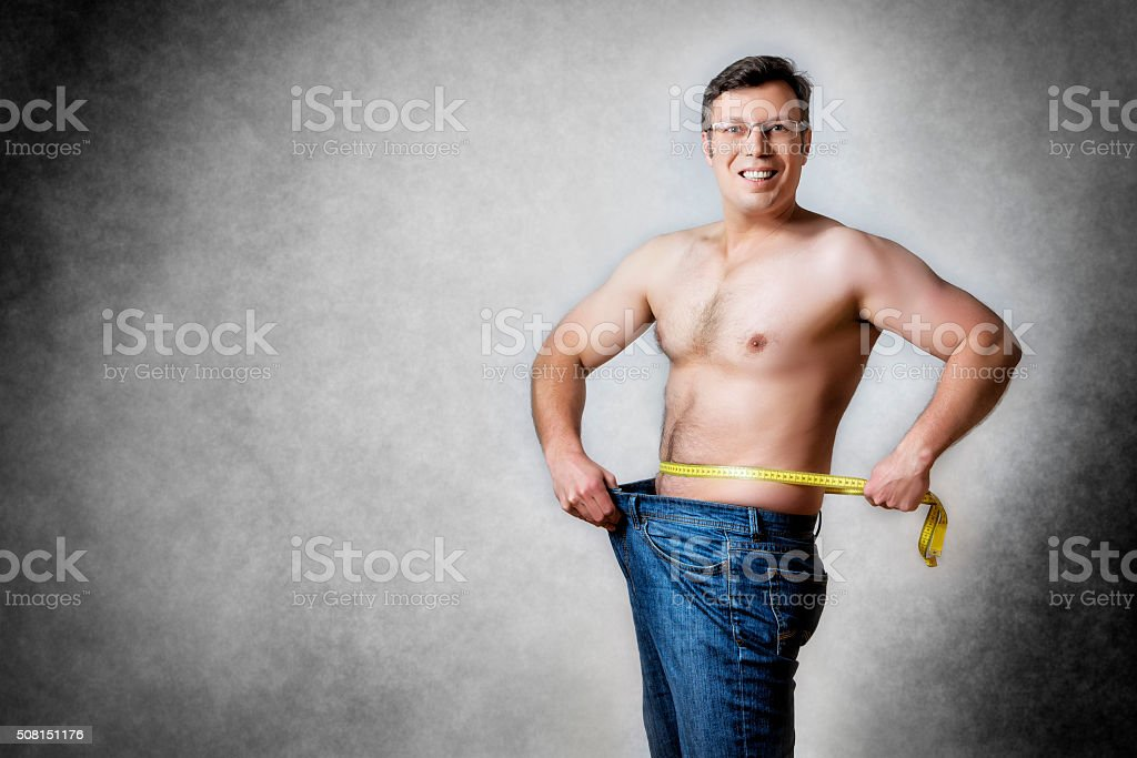 man with measuring tape stock photo
