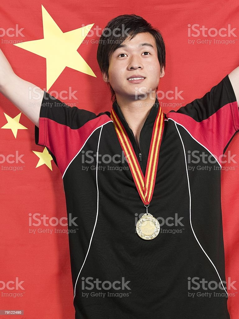 Man with medal and Chinese flag 免版稅 stock photo