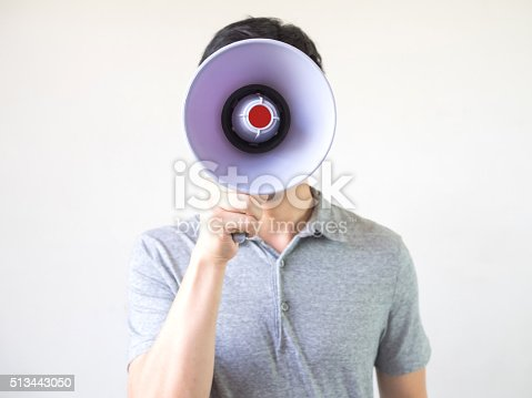 istock Man with megaphone in hand on the white background 513443050