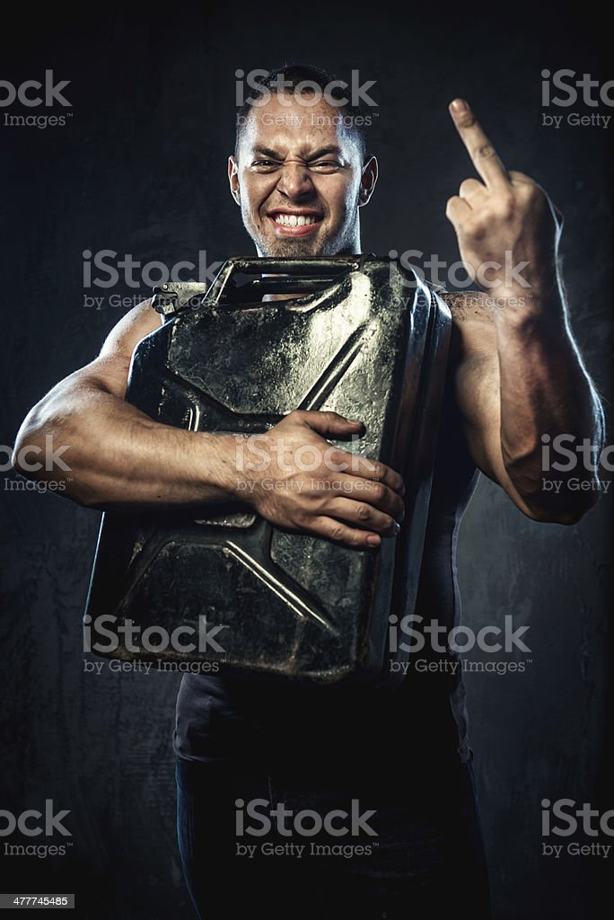 Man with metal fuel can royalty-free stock photo