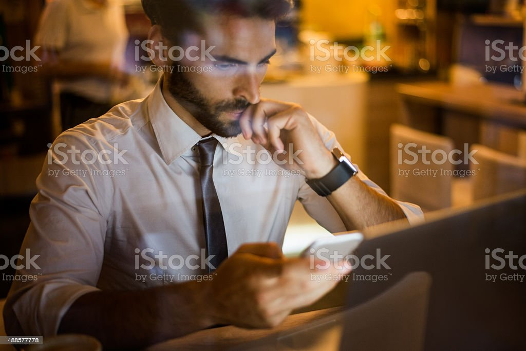 Man with mobile phone in coffee shop stock photo