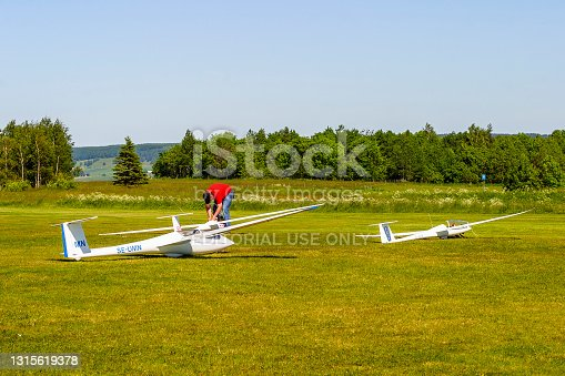 Falköping, Sweden - June 19, 2017: Man with Model airplanes on a grass runway