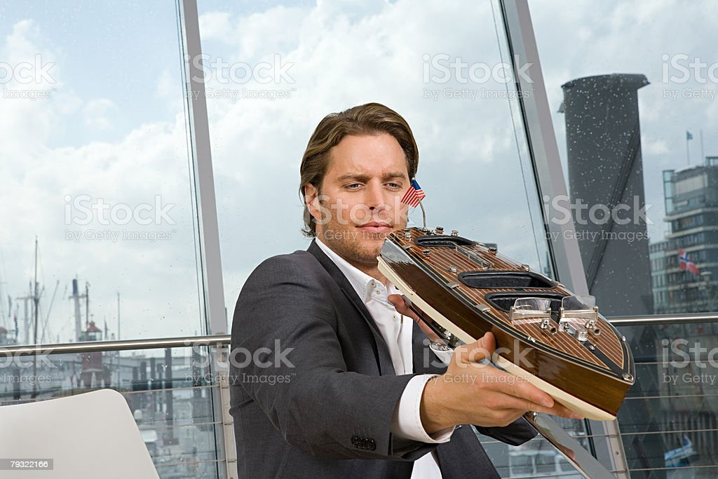 Man with model boat 免版稅 stock photo