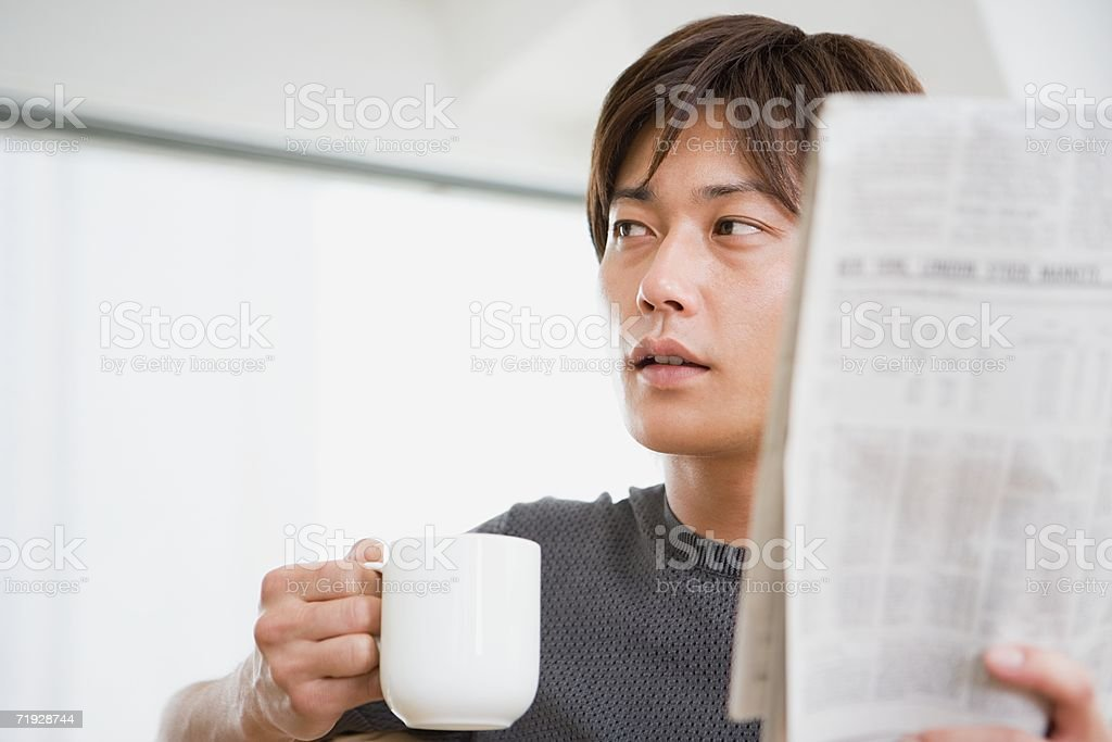 Man with morning newspaper royalty-free stock photo