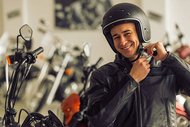 Man with motorbike stock photo
