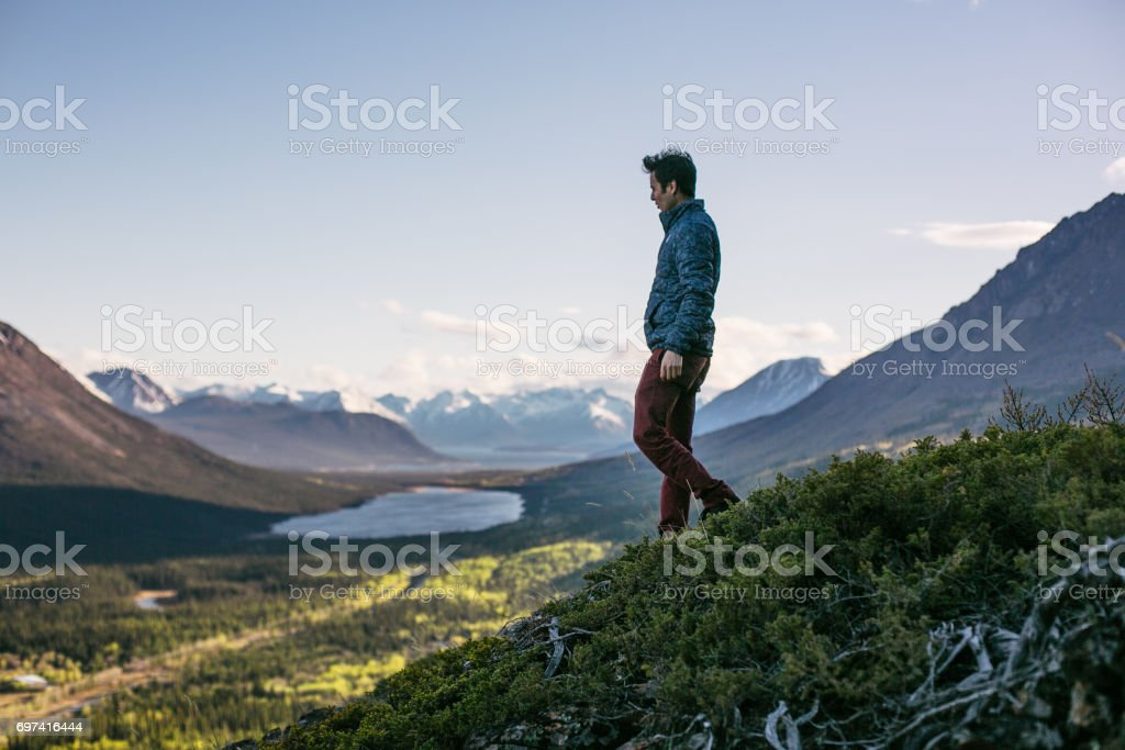 man with mountain stock photo