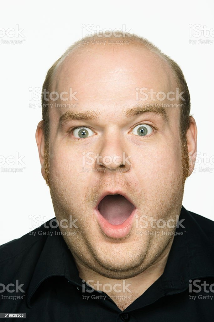Man with mouth open, portrait, close-up stock photo