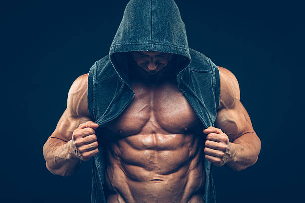 Man with muscular torso. Strong Athletic Men Fitness Model Torso stock photo