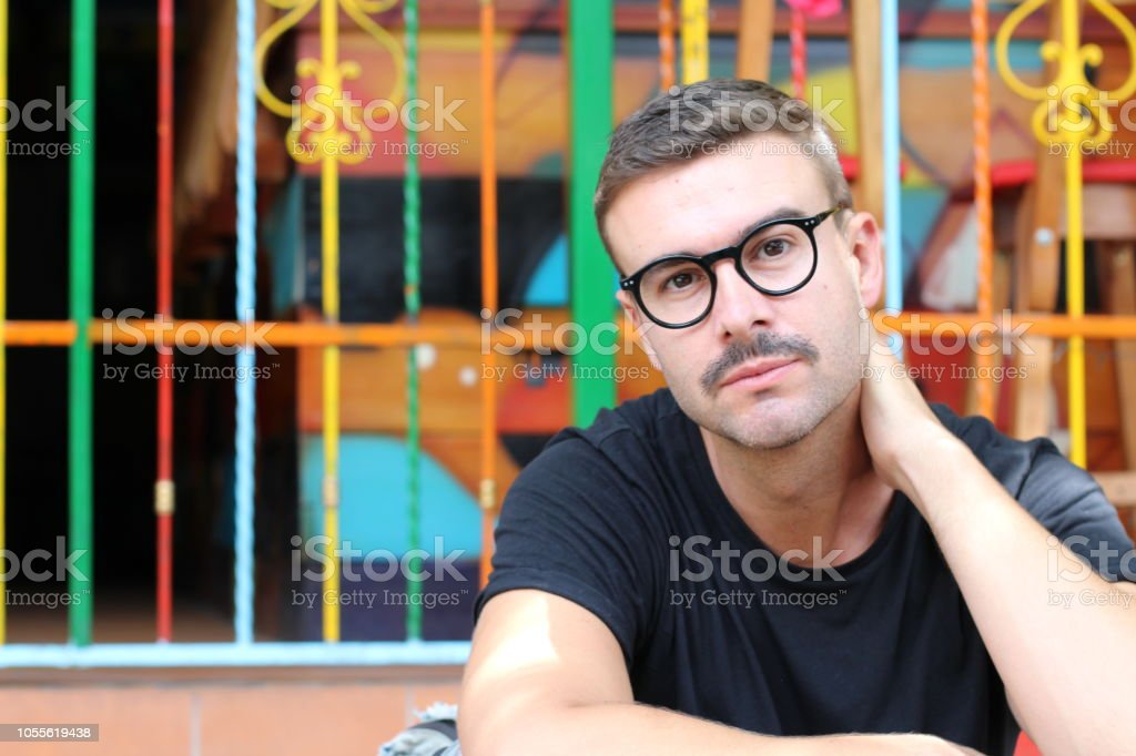Man with mustache and eyeglasses stock photo