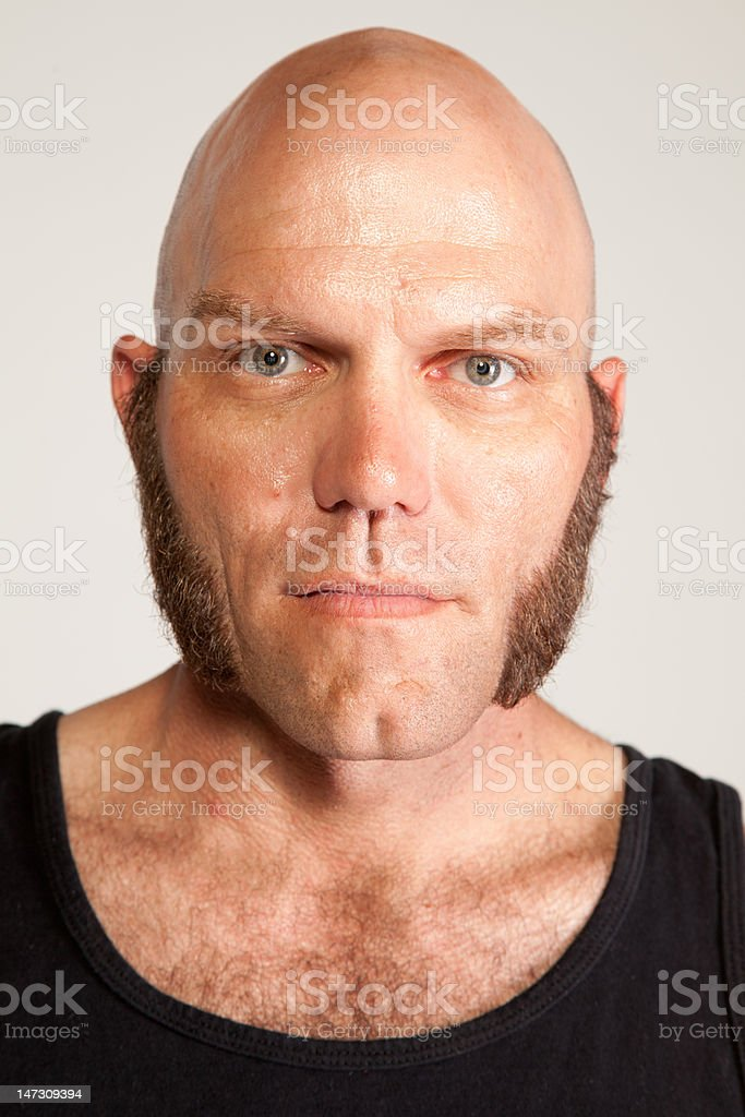 Man with Mutton Chops Looks at Camera stock photo
