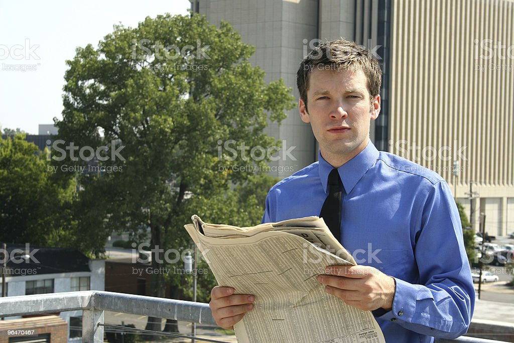 Man with Newspaper in City royalty-free stock photo