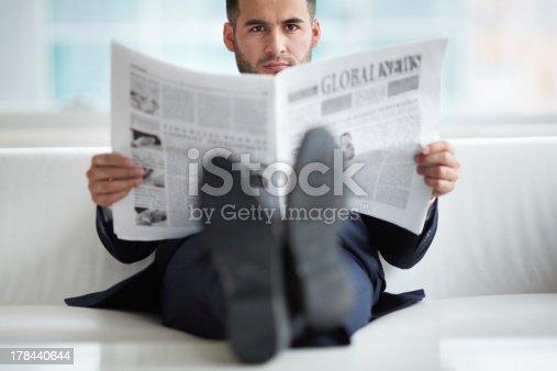 530281723istockphoto Man with newspaper 178440644