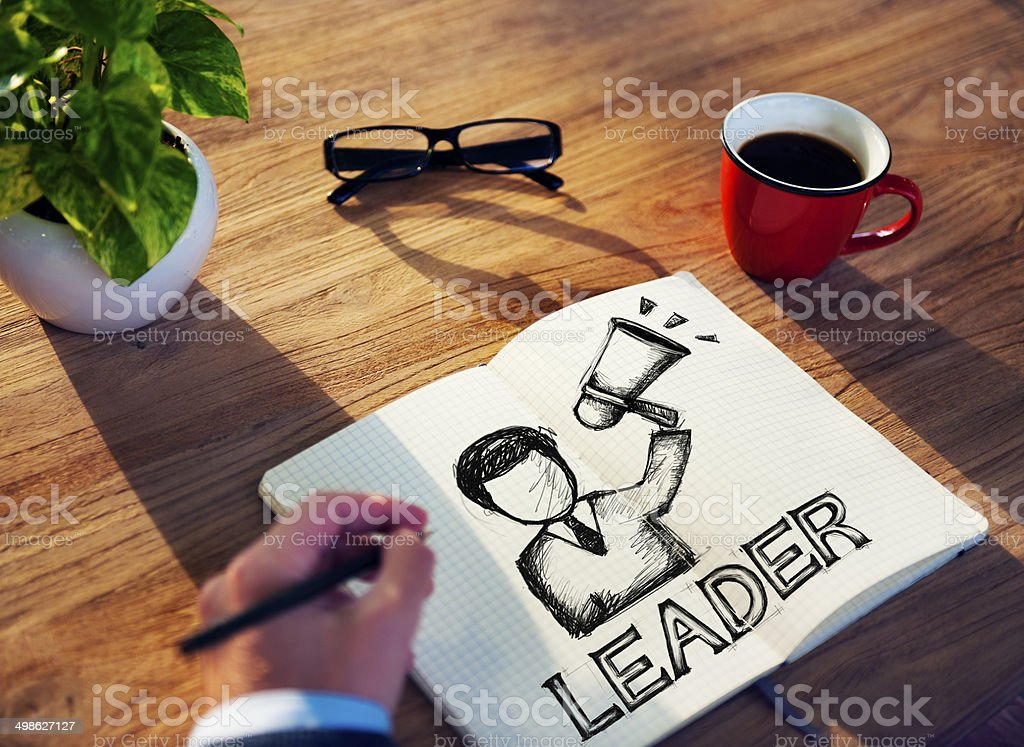 Man with Note Pad and Leadership Concepts stock photo