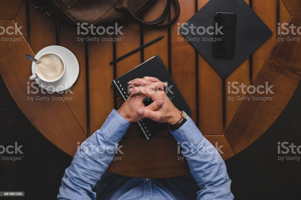 man with notepads and cup of coffee stock photo