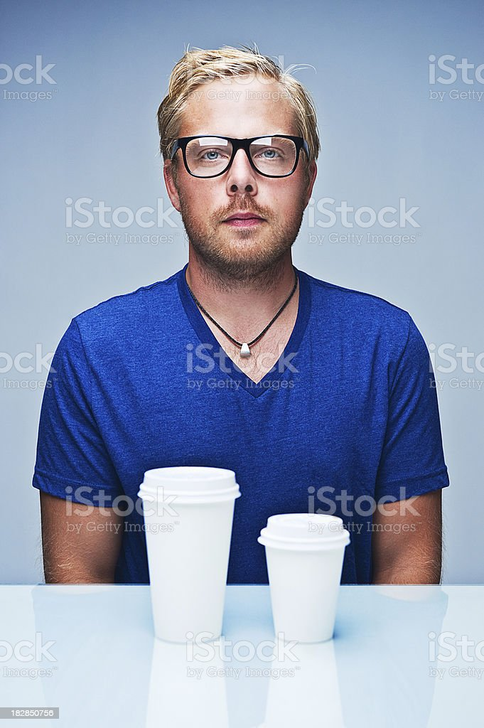 man with one big and small cup royalty-free stock photo
