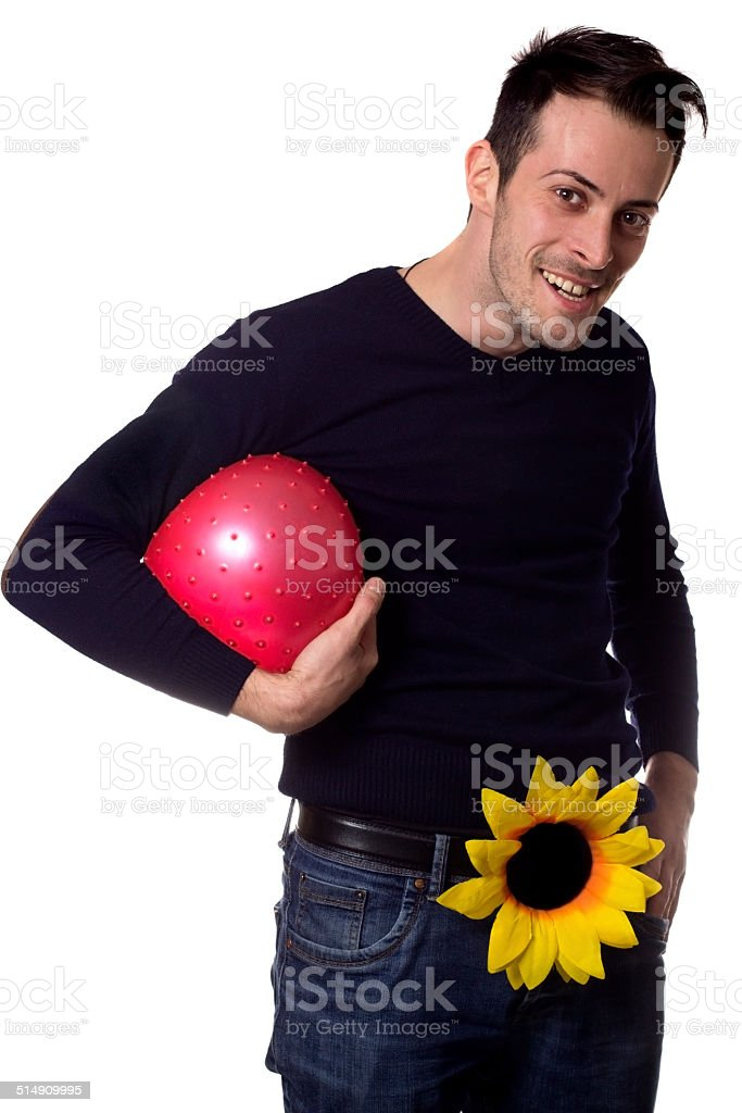 Man with one flower holding a ball stock photo