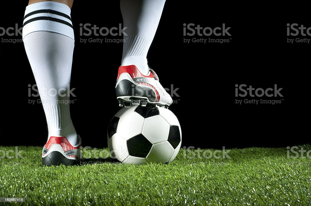Man with one foot on a soccer ball royalty-free stock photo